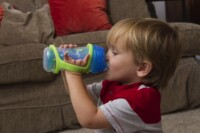 Boy using and EazyHolder with cup